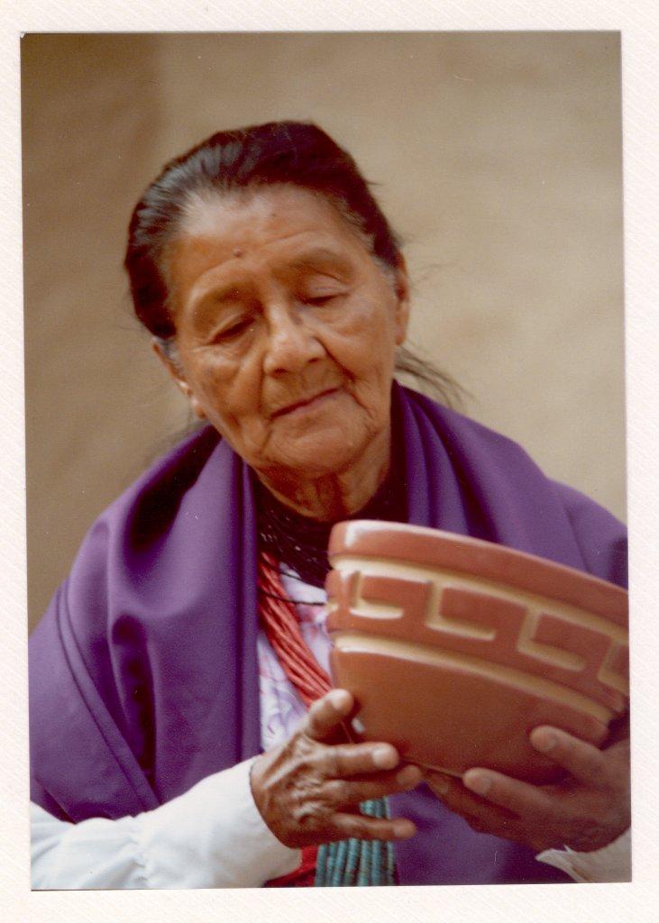 Margaret Tafoya with red polished incised bowl