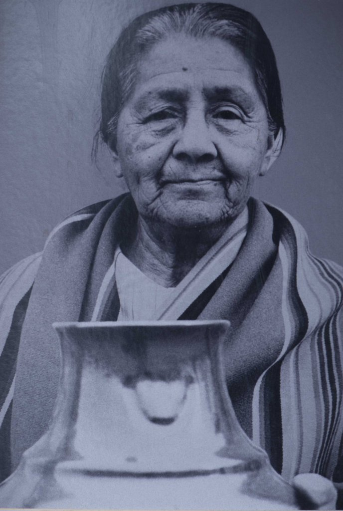 Margaret Tafoya with one of her large jars with bear paw symbol